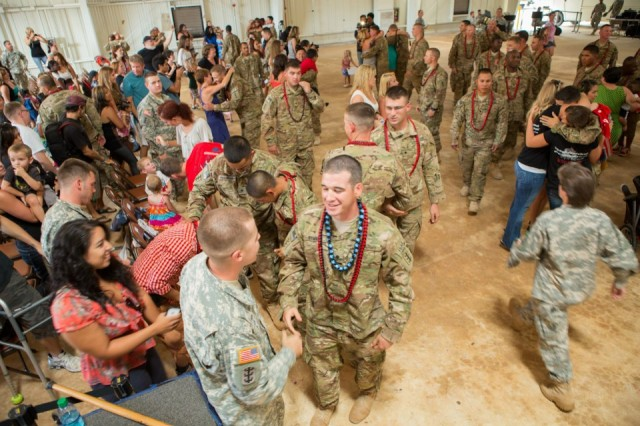 Spc. Nicholas Rymniak from the 95th Engineer Company (Clearance), 65th Eng. Battalion, 130th Eng. Brigade, 8th Theater Sustainment Command is greeted by family and friends following a redeployment ceremony Aug. 14 at Wheeler Gulch, Wheeler Army Airfield.