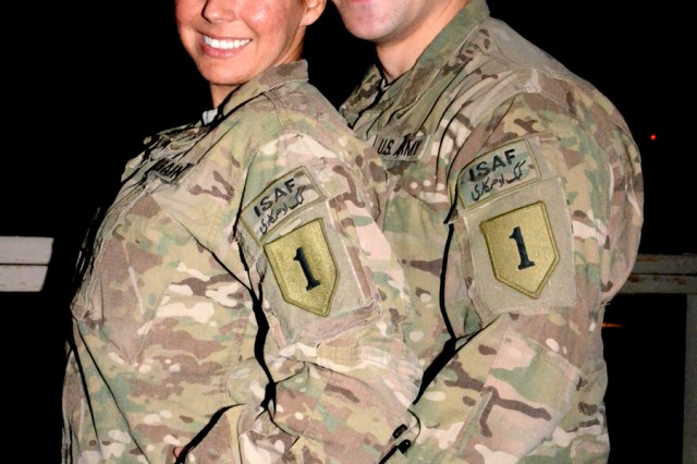 Sgt. Drew Fidler andSpc. Michelle Williams, both from Division Headquarters and Headquarters Battalion, 1st Infantry Division, stationed at Bagram Airfield, Afghanistan, pose for a picture at their impromptu wedding reception Aug. 25, 2012. The two were married via a double-proxy marriage through the state of Montana.