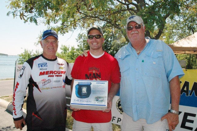 Staff Sgt. Jon Brennan, center, with American Bass Anglers boaters Ray Templeton, left, and Jim Clay. Brennan won the visiting military tournament with a 19-and-a-half inch largemouth. The prizes were a portable fish finder, courtesy of Mid Kansas Marine, and a $50 gift card from the McConnell Army Air Force Exchange.