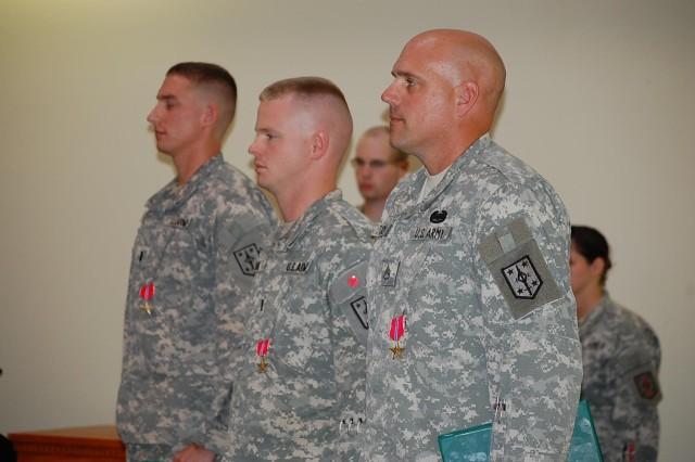 FORT LEONARD WOOD, Mo. -- 1st Lt. Landon Carl, 1st Lt. Jonathan Cross and Staff Sgt. Gregory Taylor, combat engineers assigned to 509th Clearance Company, 5th Engineer Battalion, receive Bronze Star medals Aug. 9 in Specker Chapel for their performance during a deployment in support of Operation Enduring Freedom. The 509th Clearance Company is part of the 4th Maneuver Enhancement Brigade. (Photo by: U.S. Army Cpt. Jeffrey Nichols, 5th Engineer Battalion Unit Public Affairs Representative)