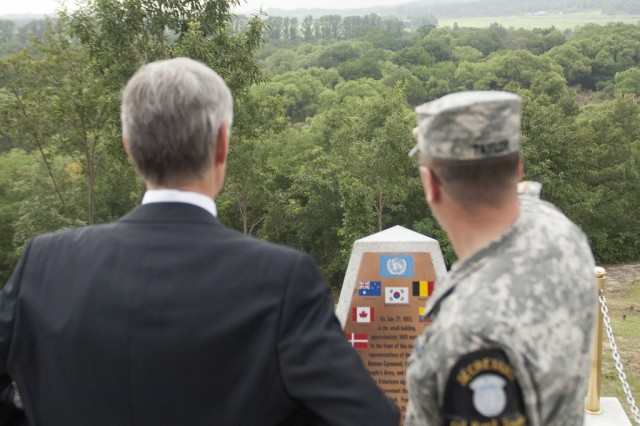U.S. Army Col. Kurt Taylor, with the United Nations Command Military Armistice Commission, points out specific landmarks to Secretary of the Army John McHugh during his visit to Observation Post Ouellette, located in the truce village of Panmunjom, South Korea, Aug 17, 2012.   (U.S. Army photo by Spc. John G. Martinez)