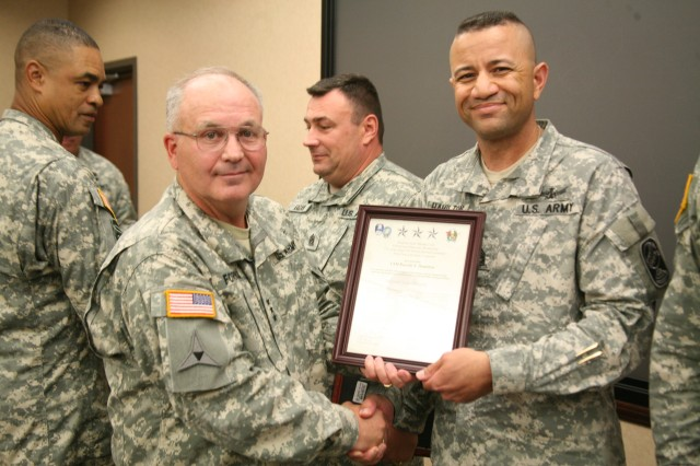 Lt. Gen. Richard P. Formica, commanding general, U.S. Army Space and Missile Defense Command/Army Forces Strategic Command, left, presents Command Sgt. Maj. Russ Hamilton, command sergeant major, 100th Missile Defense Brigade, with an honory Sergeant Audie Murphy Club membership certificate during a ceremony at the command's Redstone Arsenal headquarters Aug. 13.