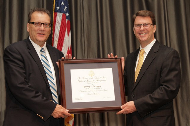 TACOM LCMC Deputy Chief of Staff for Human Capital Tim Tarczynski (left) received an award in recognition of his service to the Detroit Federal Executive Board office from U.S. Office of Personnel Management Director  John Barry.