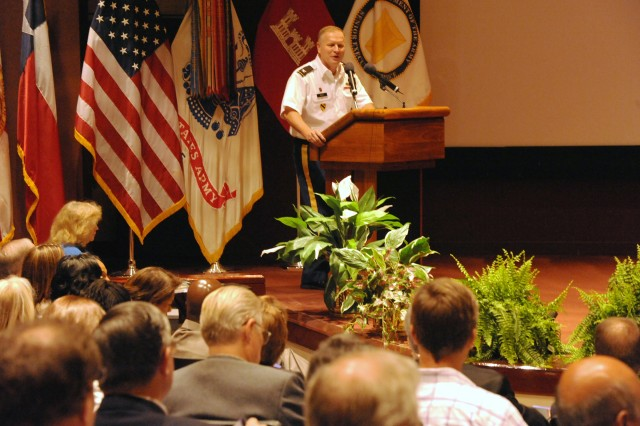 COL Robert J. Ruch, commander, U.S. Army Engineering and Support Center, Huntsville, welcomes attendees to the pre-proposal conference for a $7 billion in shared capacity multiple award task order contract for Renewable and Alternative Energy Power Production for DOD Installations, Aug. 22, 2012, at the Bob Jones Auditorium on Redstone Arsenal, Ala.