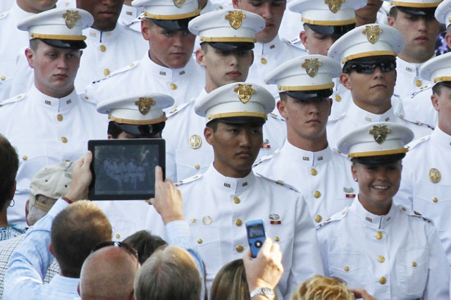 The Class of 2013 cadets march down the steps of the Trophy Point Amphitheater while hundreds of parents, friends, graduates and guests use cameras, cell phones and tablets to capture all the moments of Ring Weekend.