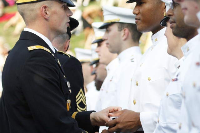 The Class of 2013 cadets receive their rings from the tactical officers and noncommissioned officers of the Corps of Cadets at the Class Ring Ceremony at Trophy Point, West Point, N.Y., Aug. 24, 2012.
