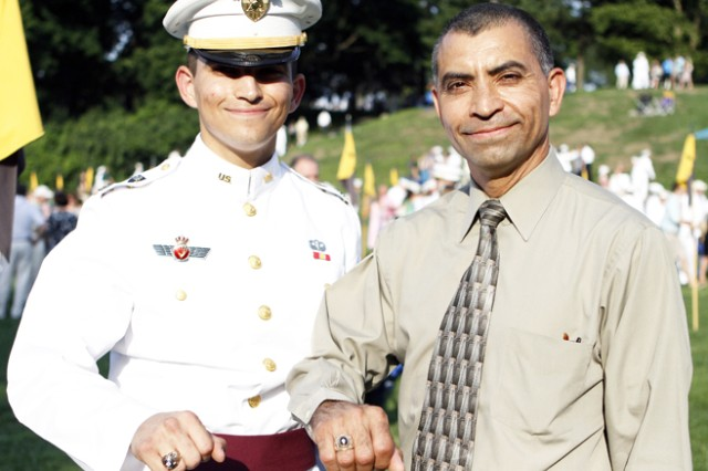 Class of 2013 Cadet Joseph Valenzuela is joined by his father, Col. Lorenzo Valenzuela, at the Class Ring Ceremony. His father is a Class of 1983 graduate and assistant professor in the Department of Systems Engineering.