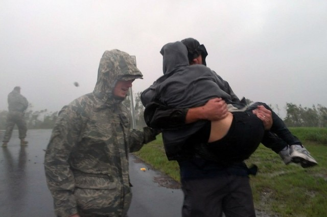 An Airmen from the Louisiana Air National Guard assists local authorities with evacuating residents of Braithwaite, La., in Plaquemines Parish as Hurricane Isaac makes landfall, Aug. 29, 2012. Louisiana Guard members were in place prior to Isaac making landfall and have been assisting local authorities with safety and security throughout the area.