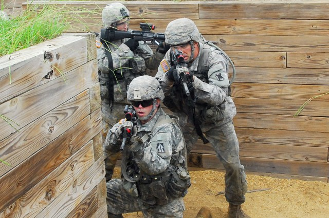 """2nd Lts. Ryan Hart, Christopher Gamble and John Peck clear a trench as members of a """"rolling T"""" formation Wednesday during the dry run of a platoon live fire at Galloway Range. After the dry run, Soldiers conducted a blank fire, followed by a live fire."""