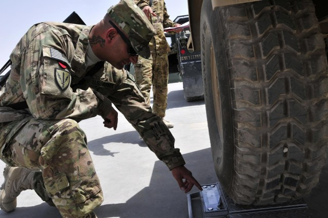 Sgt. Nathan Lavoie, supply sergeant, Headquarters and Headquarters Company, 25th Combat Aviation Brigade, checks the weight of a trailer to be shipped back to the states as part of the 209th Aviation Support Battalion, 25th CAB Unit Movement Officer Rodeo Competition as part of pre-redeployment training on Kandahar Airfield, Afghanistan, Aug. 15.