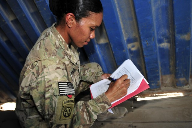 Staff Sgt. Crystal France, unit movement officer representative, Company B, 209th Aviation Support Battalion, 25th Combat Aviation Brigade, writes down deficiencies of a container to be shipped back to the states as part of the 209th ASB, 25th CAB UMO Rodeo Competition as part of pre-redeployment training on Kandahar Airfield, Afghanistan, Aug. 15.
