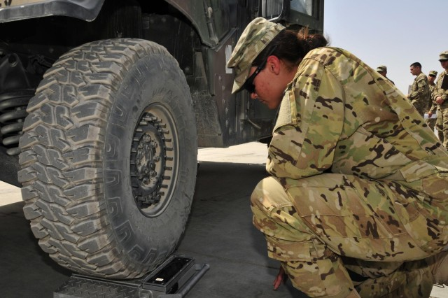 Sgt. Bridget Pena, a UH-60 Black Hawk repairer with Company A, 3rd Battalion, 25th Aviation Regiment, 25th Combat Aviation Brigade, checks the weight of a humvee to be shipped back to the states as part of the 209th ASB, 25th CAB Unit Movement Officer Rodeo Competition as part of pre-redeployment training on Kandahar Airfield, Afghanistan, Aug. 15.