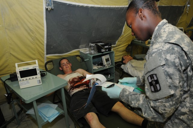 Army Reserve Soldiers from the 325th Combat Support Hospital, 139th Medical Brigade, 807th Medical Command (Deployment Support), deployed from Independence, Missouri, work on patients, in an 84-bed combat support hospital that the unit built from the ground up a week prior, in a mass casualty exercise for disaster relief on Sagami (Army) General Depot in Sagamihara, Japan, during U.S. Army Pacific's Medical Exercise 2012, Aug. 28, 2012.