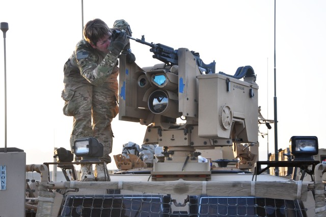 Staff Sgt. Katie Werginz, a truck driver with the 1157th Transportation Company, goes through the bore sighting procedures on top of a Mine-Resistant Ambush vehicle on August 23, 2012 at Bagram Airfield. Bore sighting is used to zero a weapon, which will allow a gunner to fire rounds more accurately on the battlefield. (U.S. Army photo by Sgt. Gregory Williams)