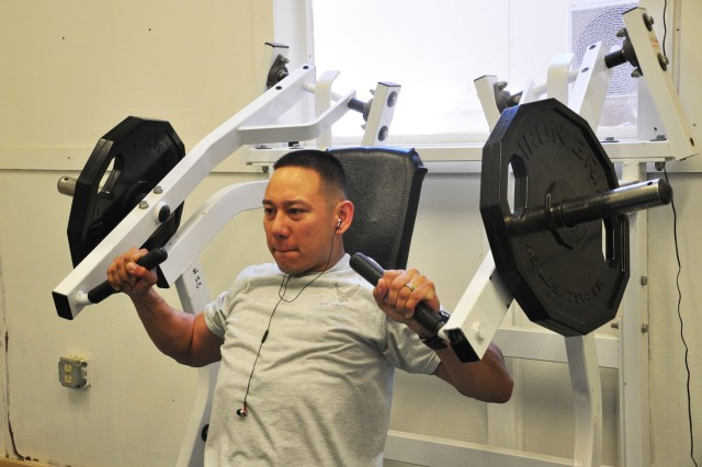 Senior Airmen Anthony Montejo, a combat medic attached to the 10th Sustainment Brigade, works out before a convoy mission on August 23, 2012 at Bagram Airfield.  (U.S. Army photo by Sgt. Gregory Williams)