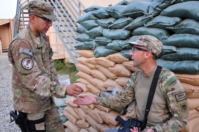 Senior Airmen Anthony Montejo, a combat medic attached to the 10th Sustainment Brigade, attends to Sgt. 1st Class Jason R. Mattke, a convoy commander, 1157th Transportation Company, on August 24, 2012 at Jalalabad Airfield. (U.S. Army photo by Sgt. Gregory Williams)