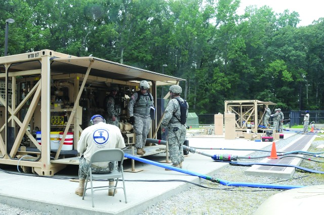 Teams operate the Tactical Water Purification Systems at Training Area 19 during that event of the 2012 Water Purification Rodeo, held Aug. 17-24, 2012, at Fort Story, Va., and Fort Lee, Va.  Seventeen teams competed in five events during the annual competition.