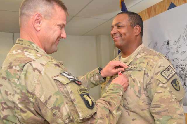 Lt. Col. Stanley J. Sliwinski, AFSBn-Kandahar, 401st Army Field Support Brigade commander, awards a Bronze Star Medal to Command Sgt. Maj. Errol J. White, AFSBn-Kandahar, command sergeant major, during an awards ceremony Aug. 26 at battalion headquarters.