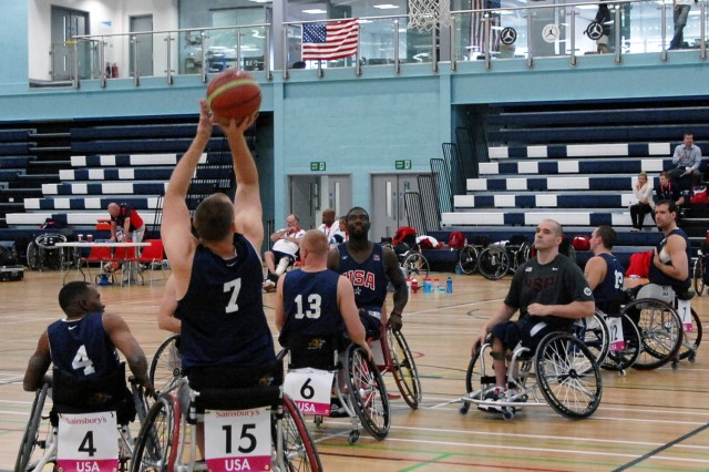 Members of the 2012 U.S. Paralympic basketball team warm up before a scrimmage with Great Britain's Paralympic team at the University of East London's campus facility, the Sports Dock, Aug. 29, 2012.