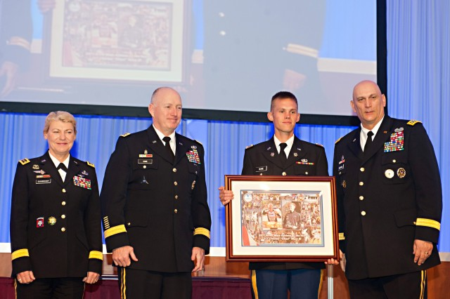 From left, Gen. Ann E. Dunwoody, commanding general, U.S. Army Materiel Command; Gen. Robert W. Cone, commanding general, U.S. Army Training and Doctrine Command; and Army Chief of Staff Gen. Raymond T. Odierno, present the 2011 Male Athlete of the Year Award to 1st Lt. Charles Ware III at the Association of the U.S. Army Winter Symposium in Ft. Lauderdale, Fla., Feb. 24, 2012.