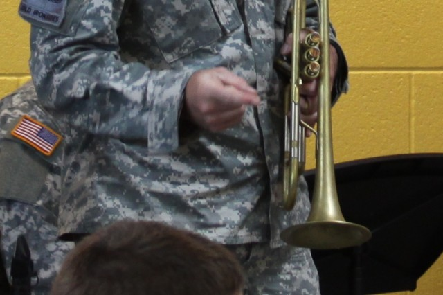 Sgt. Nathan Egts, a trumpet player with the U.S. Army Military Intelligence Corps Band, teaches students about the trumpet during a demonstration at Smith Middle School on Aug. 22.