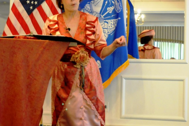 New Jersey actress Michele LaRue explains her satirical anti-suffrage performance in its historical context at the Rock Island Arsenal Island Clubhouse Aug. 24. (Photo by Susan Matos, ASC Public Affairs)