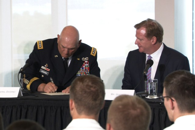 Army Chief of Staff Gen. Ray Odierno and NFL commissioner Roger Goodell sign a letter Aug. 30 formalizing the initiative between the Army and the NFL to help raise awareness about traumatic brain injury.
