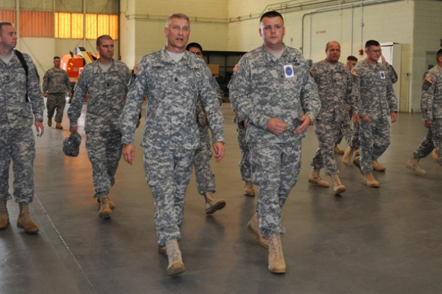 Sgt. Maj. of the Army Raymond F. Chandler III is escorted by Staff Sgt. Jeremy Patterson, of C Co., 1st Bn., 13th Avn. Regt., through Yano Hall to observe Soldiers in training during his visit to Fort Rucker Aug. 22.