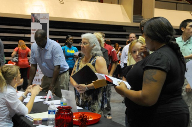 Representatives from Personnel Resources meet with attendees of the ninth annual Fort Rucker Job Fair held Aug. 22 in Ozark.