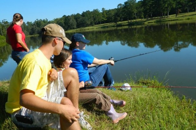 BOSS members and Family members gather for a fishing trip benefitting S.O.S. and Hearts Apart last fall.