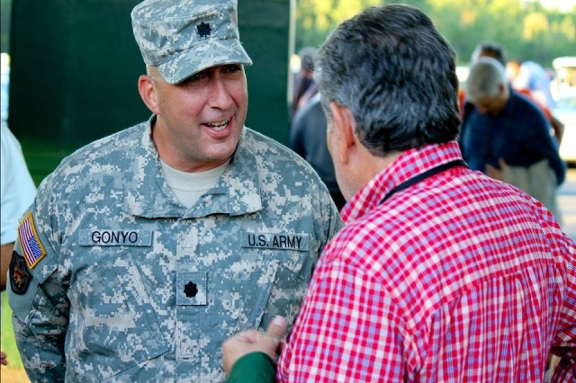 "(left) Lt. Col. James Gonyo II, commander of the 1st Battalion, 69th Infantry ""Fighting 69th"", speaks with Vernon Downs Hotel and Casino owner Jeff Gural before the start of a concert featuring Bruce Springsteen and the E-Street Band Aug. 29. Gonyo came up from New York City to support the United Services Organization of Metropolitan New York and thank Gural for his contributions and continued support to service members. Gural donated more than $150,000 to the USO so they could purchase 2,500 tickets for service members to attend the concert. Additionally, Gural will donate $2 of every ticket sold to the Central New York Veteran's Outreach Center. 30,000 fans were expected to attend the show."
