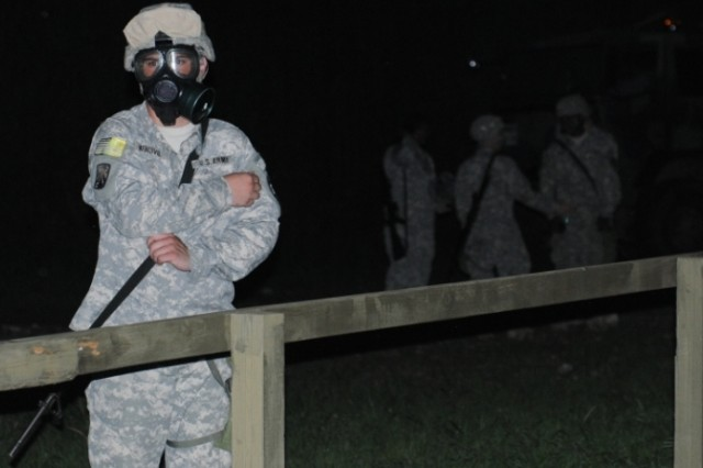 Pvt. Aaron Mendivil, a water treatment specialist from the Headquarters and Headquarters Company, 501st Special Troops Battalion, prepares to enter gas chamber during the peninsula-wide exercise Ulchi Freedom Guardian, on Camp Casey, South Korea, Aug. 24, 2012.