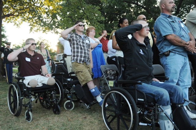 Wounded Warriors from Walter Reed National Medical Center, Md., salute during the national anthem at the Twilight Tattoo performed on Whipple field at Joint Base Myer-Henderson Hall, Va., Aug. 29, 2012.