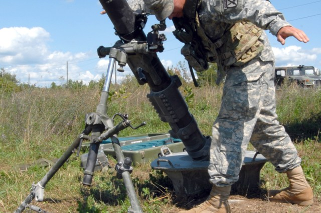 A Soldier with 1st Squadron, 89th Cavalry Regiment, 2nd Brigade Combat Team, 10th Mountain Division (LI), sets up his mortar system last week in a  training area at Fort Drum, N.Y., with the new One Tactical Engagement Simulation System.