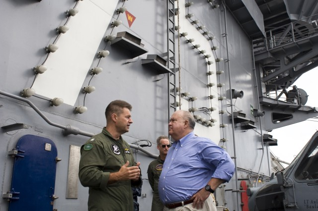 Under Secretary of the U.S. Army Joseph W. Westphal, (far right), on the flight deck of the aircraft carrier USS Harry S. Truman (CVN 75) speaking with Cmdr. Paul Movizzo, commanding officer of the Grayhawks of carrier airborne early warning squadron (VAW) 120, as Dr. Westphal participates in the U.S. Navy's Sea Embark outreach program, Sept. 3, 2012 on the Atlantic Ocean.  Under Secretary Westphal is participating in the Navy's long-standing outreach program to promote inter-Service cooperation in support of Joint Vision 2020, and gain an appreciation for Naval capabilities at sea.  The Navy's Sea Embark outreach program enables government and civilian senior leaders the ability to experience first-hand how the Navy contributes to the National Defense strategy and to the stability of the global community.  (U.S. Navy photo by Mass Communication Specialist 3rd Class Tyler Caswell/Released)