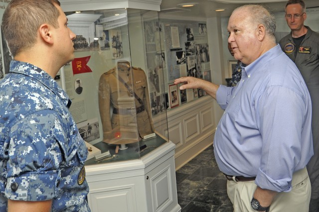 """Under Secretary of the U.S. Army Joseph W. Westphal in the """"Truman Room"""" aboard the aircraft carrier USS Harry S. Truman (CVN 75) speaking with Mass Communication Specialist 2nd Class Mick Dimestico about a replica of the uniform President Harry S. Truman would've worn as Dr. Westphal participates in the U.S. Navy's Sea Embark outreach program, Sept. 3, 2012 on the Atlantic Ocean.  Under Secretary Westphal is participating in the Navy's long-standing outreach program to promote inter-Service cooperation in support of Joint Vision 2020, and gain an appreciation for Naval capabilities at sea.  The Navy's Sea Embark outreach program enables government and civilian senior leaders the ability to experience first-hand how the Navy contributes to the National Defense strategy and to the stability of the global community. (U.S. Navy photo by Mass Communication Specialist Seaman Jamie Cosby/Released)"""