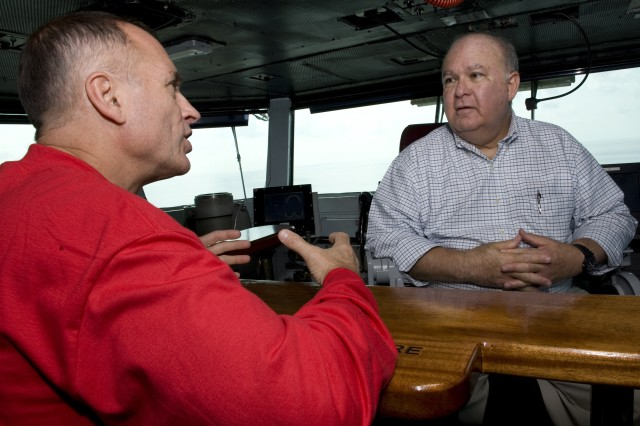 Capt. S. Robert Roth, commanding officer of USS Harry S. Truman (CVN 75), speaks with Under Secretary of the U.S. Army Joseph W. Westphal on the ship's bridge as Dr. Westphal participates in the U.S. Navy's Sea Embark outreach program, Sept. 2, 2012 on the Atlantic Ocean.  Under Secretary Westphal is participating in the Navy's long-standing outreach program to promote inter-Service cooperation in support of Joint Vision 2020, and gain an appreciation for Naval capabilities at sea.  The Navy's Sea Embark outreach program enables government and civilian senior leaders the ability to experience first-hand how the Navy contributes to the National Defense strategy and to the stability of the global community.  (U.S. Navy photo by Mass Communication Specialist 3rd Class Donald R. White Jr./Released)