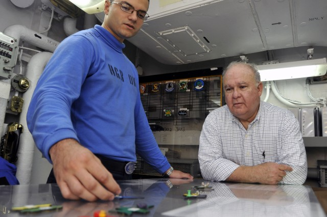 Aviation Boatswain's Mate (Handling) Airman Peter Mannarino gives Under Secretary of the U.S. Army Joseph W. Westphal a tour of hangar deck control during his visit to the aircraft carrier USS Harry S. Truman (CVN 75) as he participates in the U.S. Navy's Sea Embark outreach program, Sept. 2, 2012 on the Atlantic Ocean.  Under Secretary Westphal is participating in the Navy's long-standing outreach program to promote inter-Service cooperation in support of Joint Vision 2020, and gain an appreciation for Naval capabilities at sea.  The Navy's Sea Embark outreach program enables government and civilian senior leaders the ability to experience first-hand how the Navy contributes to the National Defense strategy and to the stability of the global community.  (U.S. Navy photo by Mass Communication Specialist Seaman Lorenzo J. Burleson/Released)