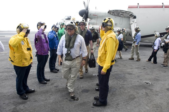 Under Secretary of the U.S. Army Joseph W. Westphal passes through side boys rendering honors on the flight deck of the aircraft carrier USS Harry S. Truman (CVN 75) as he participates in the U.S. Navy's Sea Embark outreach program, Sept. 2, 2012 on the Atlantic Ocean.  Under Secretary Westphal is participating in the Navy's long-standing outreach program to promote inter-Service cooperation in support of Joint Vision 2020, and gain an appreciation for Naval capabilities at sea.  The Navy's Sea Embark outreach program enables government and civilian senior leaders the ability to experience first-hand how the Navy contributes to the National Defense strategy and to the stability of the global community.  (U.S. Navy photo by Mass Communication Specialist 3rd Class Tyler Caswell/Released)