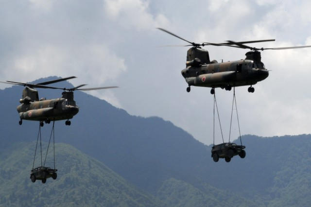CH-47J helicopters carry vehicles that they later off-loaded onto the ground, one of many demonstrations executed Aug. 26 during the Fuji Firepower Demonstration.