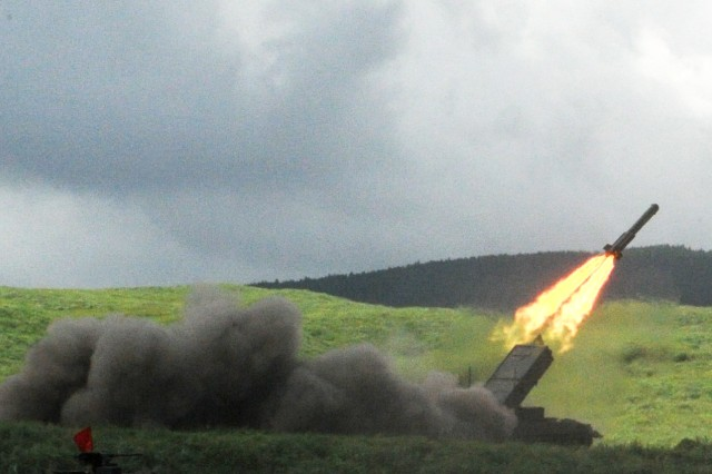 A Type-92 Minesweeper fires a rocket Aug. 26 during the Japan Ground Self-Defense Force's annual Fuji Firepower Demonstration.