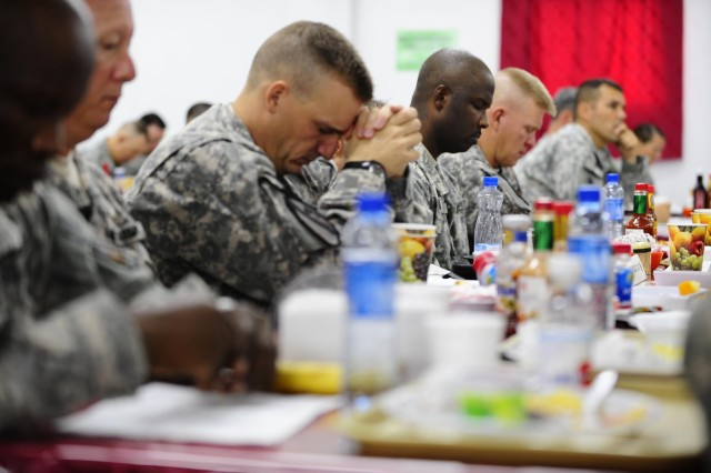 Soldiers deployed to Camp Buehring, Kuwait, take a moment to meditate or pray to their higher power or in their belief during a Spiritual Fitness Breakfast, Sept. 1, 2012. The Army's Comprehensive Soldier Fitness program encourages Soldiers to increase their spiritual fitness by accepting all faiths and beliefs to make well-rounded soldiers in today's Army.