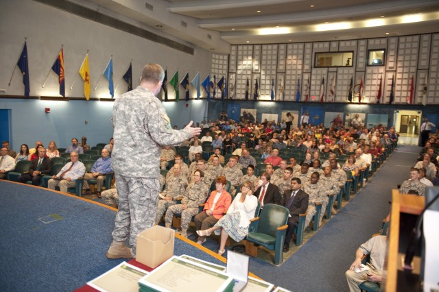 Brig. Gen. John J. McGuiness, Natick Soldier Systems Center senior commander, speaks to the NSSC workforce Aug. 30 during his final town hall meeting.
