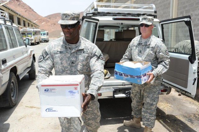 Sgt. Timothy Ryan, 3rd Squadron, 124th Cavalry Regiment, Texas Army National Guard, administration noncommissioned officer, and Sgt. 1st Class Loren Ledlow, 3-124th CAV operations noncommissioned officer, deliver several boxes of personal items for an orphanage in Dire Dawa, Ethiopia, Aug. 28, 2012. St. Augustine's, a Catholic, all-girls orphanage, has been the recipient of dozens of boxes of personal care items since February, when the 3-124th Cav. arrived at Camp Lemonnier, Djibouti.