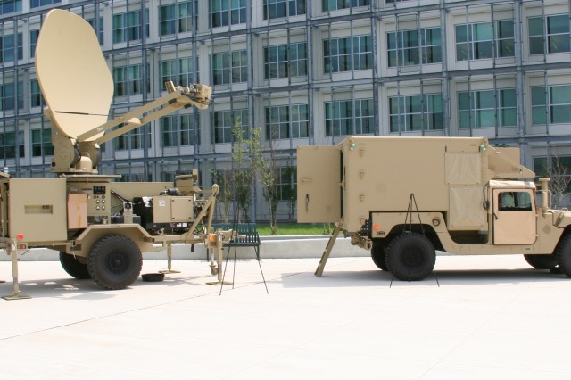 A Joint Network Node (right) and a Satellite Transportable Terminal at Aberdeen Proving Ground, Md. during the Final Fielding Celebration of Warfighter Information Network-Tactical Increment 1, Aug. 23, 2012.