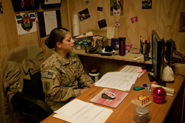 "PAKTIKA PROVINCE, Afghanistan "" Spc. Rosy Lewis, a paralegal specialist assigned to the 4th Infantry Brigade Combat Team, 1st Infantry Division, provides  legal assistance services to Soldiers throughout Task Force 4-1 Aug. 31."