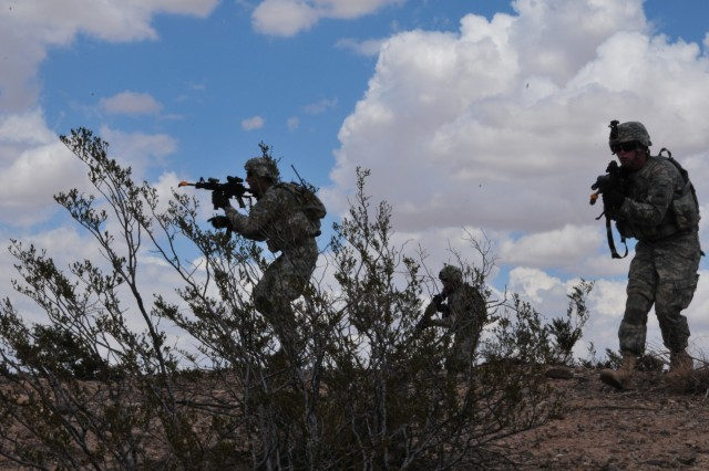 Soldiers from 1st Battalion, 35th Armored Regiment, 2nd Brigade, 1st Armored Division, train movement to contact squad tactics at Dona Ana Range, N.M., using the Rifleman Radio and Nett Warrior system. The unit deploys equipment under test and evaluation to the field and integrates it into their training for use in an operational environment.