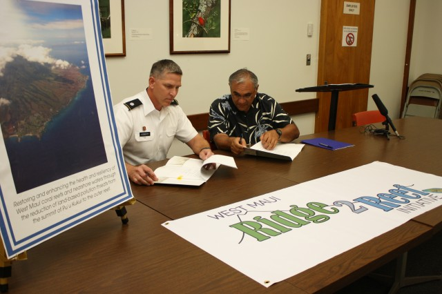 "DLNR Chairperson, William J. Aila, Jr. (right) and Lt. Col. Thomas D. Asbery, commander, U.S. Army Corps of Engineers, Honolulu District, today signed a $3 million cost-share agreement to develop a watershed plan to support the West Maui ""Ridge to Reef"" Initiative. The Initiative is one of the first efforts in the state to implement a comprehensive management strategy to address impacts to coral reefs across multiple watersheds. The watershed plan will be funded 75-percent by the Corps and 25-percent by DLNR."