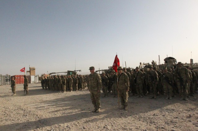 U.S. Army Capt. Joel Ellis, 870th Engineer Company commander, stands in front of his company during the transfer of authority ceremony held at Forward Operating Base Lagman, Aug. 24. The TOA ceremony signifies the transfer of responsibility from the 883rd Route Clearance Company to the 151st and the 870th En. Companies.