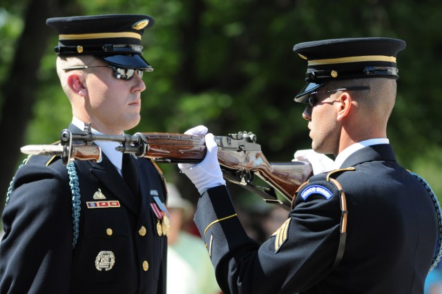 A guard changer inspects Sgt. John Baker's weapon for the last time, Aug. 31, in Arlington National Cemetery, Va. Baker, Tomb Sentinel, Tomb of the Unknown Soldier, 3d U.S. Infantry Regiment (The Old Guard), conducted his last walk after the inspection. He served 54 months at the Tomb. (U.S. Army photo by Staff Sgt. Megan Garcia)